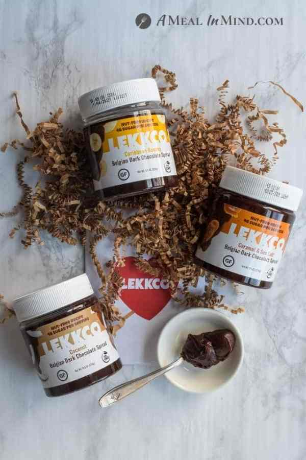 three Lekkco spread flavors with spoonful of chocolate spread
