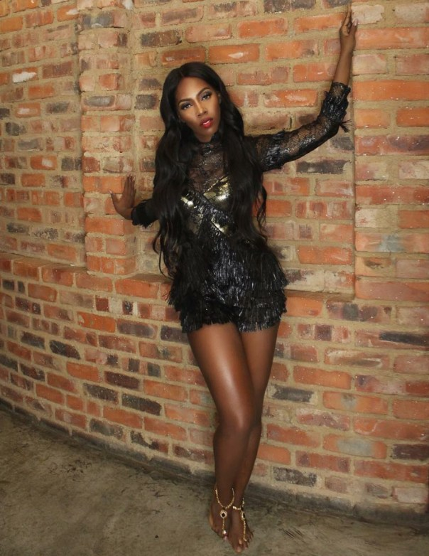 Tiwa Savage Gets Goosebumps As She Channels Her Inner Amazon Queen In Black And Gold Fringed Raffia Playsuit 3