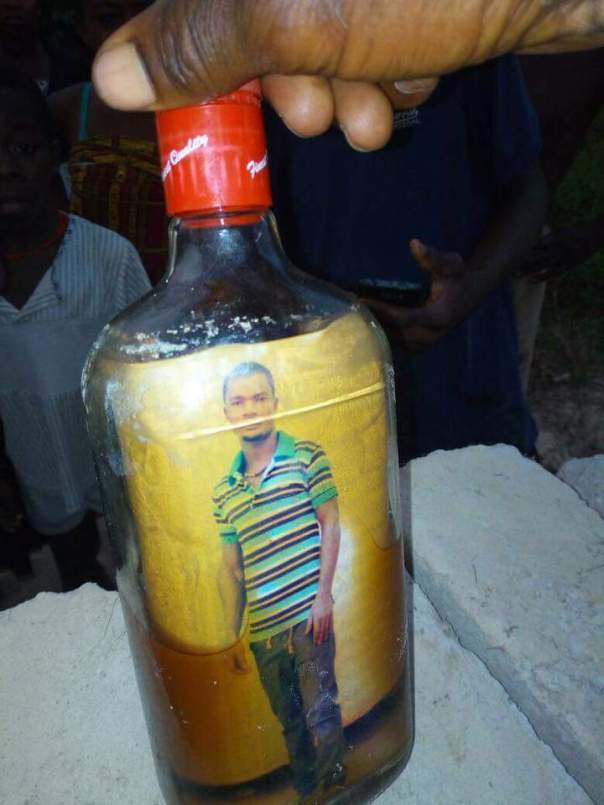 Mysterious Bottle With Picture Of Man And Crucifix (2)