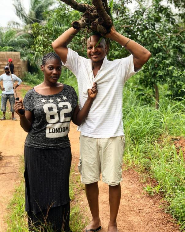 IK Ogbonna Carries Firewood While Posing With Mercy Johnson (2)
