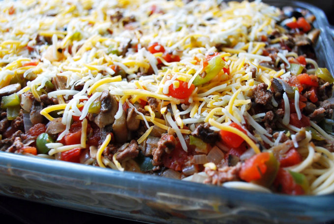 Pan of baked spaghetti casserole ready to cook
