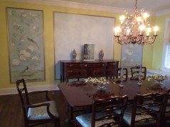 Elegant Gracie style wall panels enliven this elegant dining room.