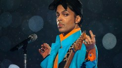 Prince performs in the rain at the 2007 Super Bowl halftime show.