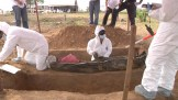 a Colombian CSI working on exhumation of Unidentified bodies.