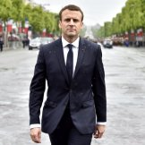 French President Emmanuel Macron arrives to lay a wreath of flower on the Unknown Soldier's tomb at the Arc of Triomphe monument after his formal inauguration ceremony as French President, Sunday, May 14, 2017 in Paris. Macron was inaugurated as France's new president at the Elysee Palace in Paris, and immediately launched into his mission to shake up French politics, world economics and the European Union. (Alain Jocard/Pool Photo via AP)