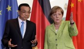German Chancellor Angela Merkel, right, and China's Premier, Li Keqiang, left, talk during a contract signing ceremony as part of a meeting at the chancellery in Berlin, Germany, Thursday, June 1, 2017. (AP Photo/Michael Sohn)