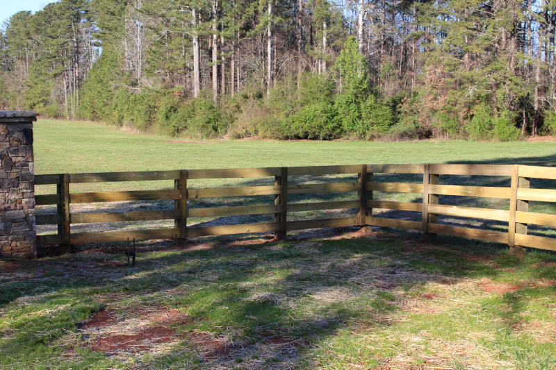 Rural Wood Fence in a Field   America Fence