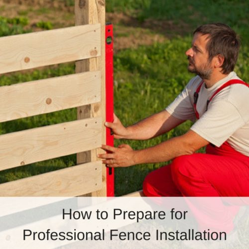Man in Red Overalls Installing a Wooden Fence | America Fence