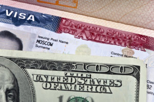 The American visa on page of the Russian international passport and US dollars