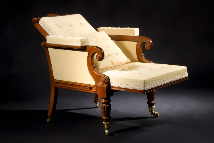 Classical Mechanical Easy Chair: Showing the back reclining and the seat sliding forward.