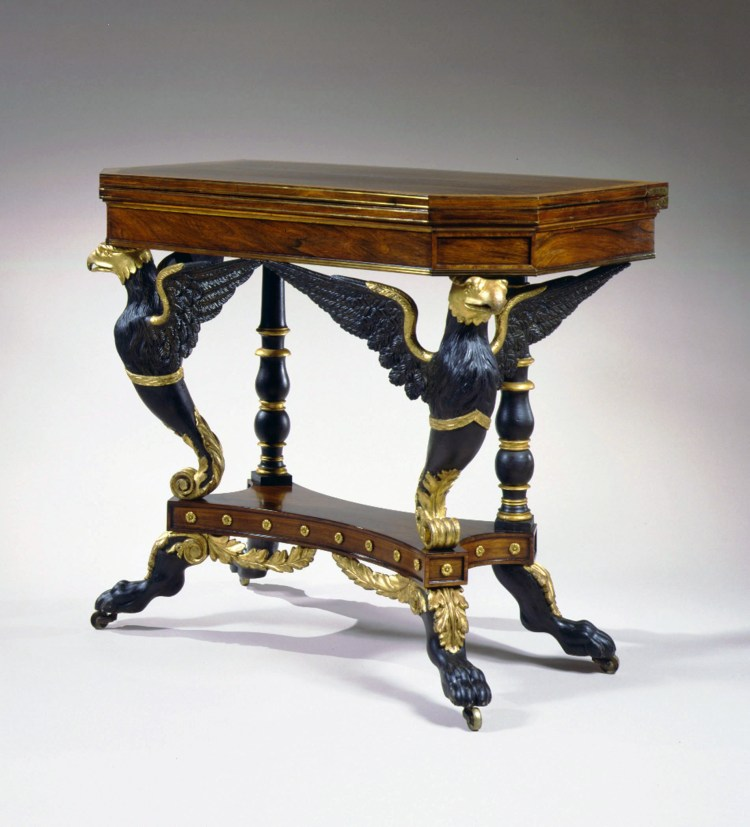 Eagle-Carved Parcel-Gilt Card Table by Duncan Phyfe: Three-quarter view showing that each carved eagle spreads its wings across the front and sides of the table beneath the case, and offers a clear view of the rear turned, baluster supports that  alternate between vert-antique paint and gilded turnings.