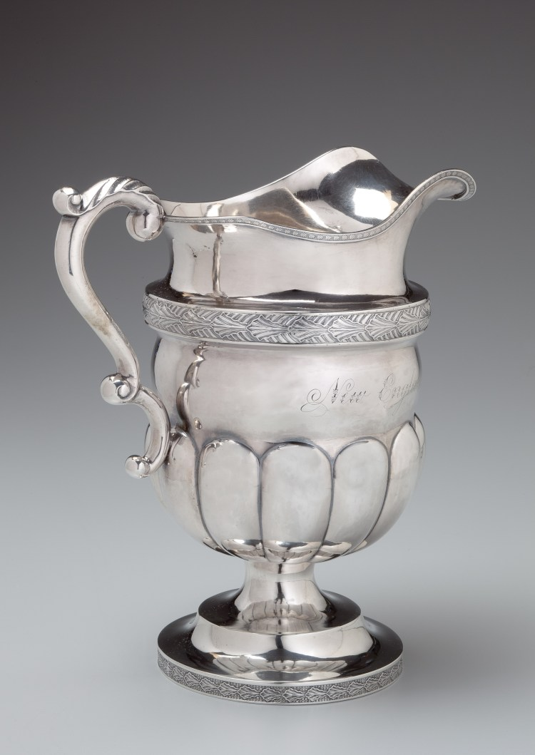 """Coin Silver Presentation Pitcher by Farnum & Ward, having an applied stamped decorative band above a mellon-lobed bowl on a footed stand, Engraved: """"New England Guards to Lemuel Blake Esq."""""""