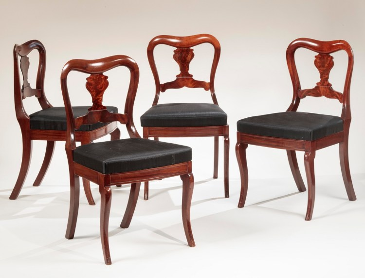 Set of Four Restauration Dining Chairs each with yoke-shaped crest rail and vase-shaped veneered splat above an upholstered slip seat and bowed front seat rail on cabriole legs. Secondary wood: ash, seat frames pine and poplar. Scalamandre black horsehair upholstery.