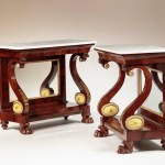 PAIR OF RESTAURATION GILT-STENCIL-DECORATED MAHOGANY PIER TABLES