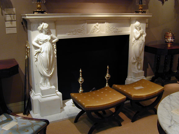 "White Marble Mantlepiece with Dancing Maidens flanking the Fire Box, Continental, 2nd Quarter 19th century. H: 50"" W: 77"" D: 15"" Firebox enclosure: H: 37"" x 47"""