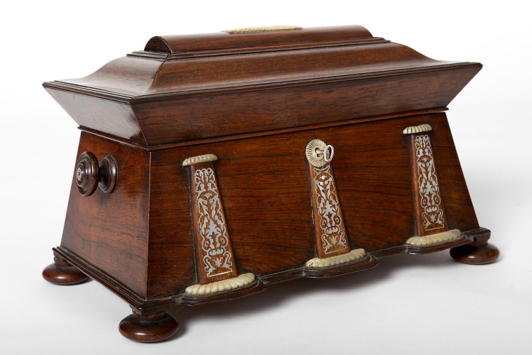 REGENCY MOTHER-OF-PEAL INLAID ROSEWOOD TEA CHEST IN EGYPTIAN TASTE, A pylon-form box on pad feet with mother-of-pearl inlay pylons-form appliques on the front.