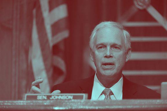 Senator Ron Jonson participates in a Senate hearing.