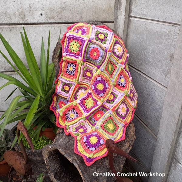 Groovy Mini Granny Square Baby Blanket Cal | @americancrochet.com @creativecrohcetworkshop.com #freecrochetpattern #freecrochetalong