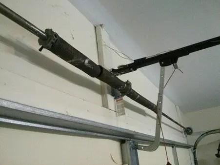 Inside of garage door showing broken spring needs maintenance