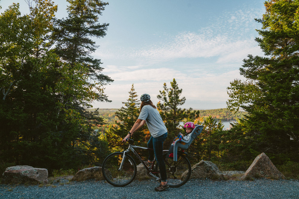 mom biking with baby in acadia national park