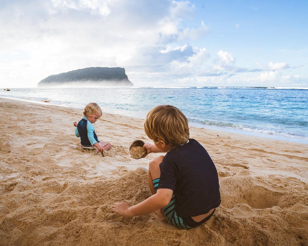 kids playing on beach in samoa