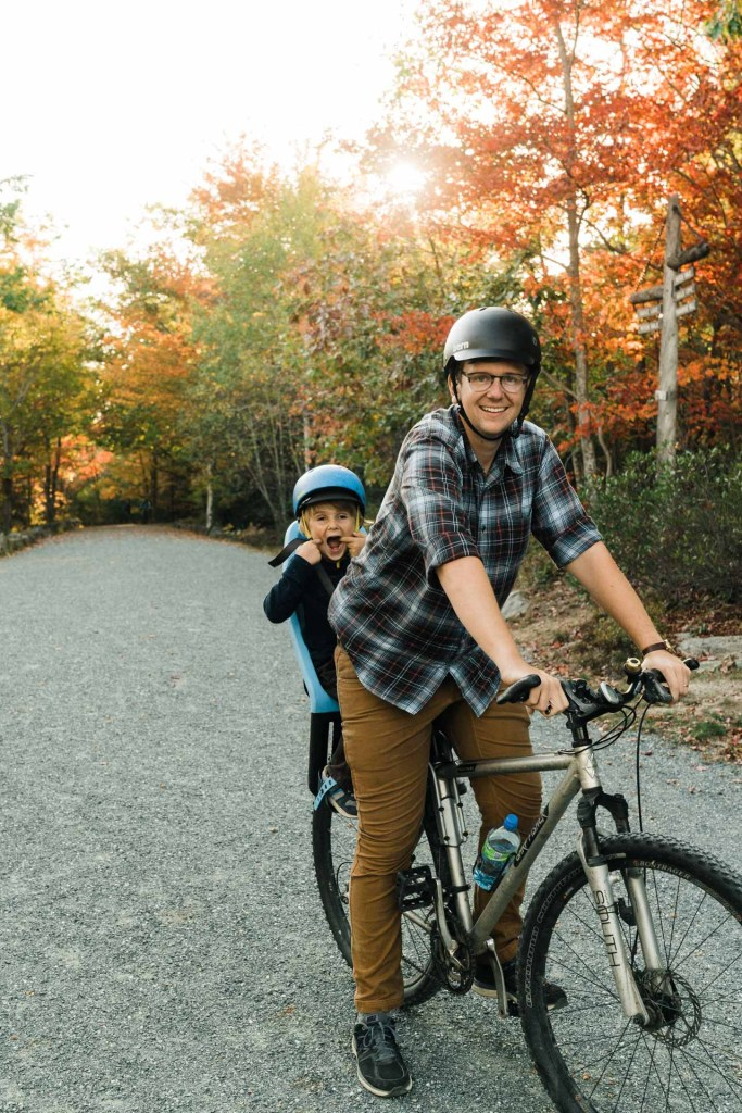 family with kids taking a bike ride on the carriage path in acadia national park