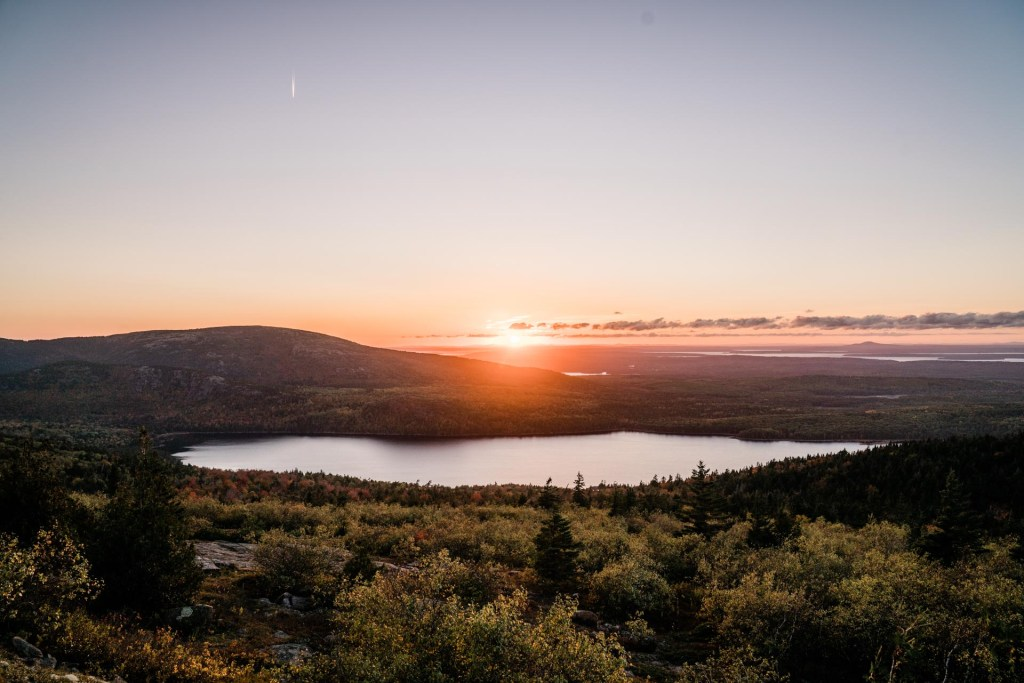 a view of the sunset from cadillac mountain in acadia national park