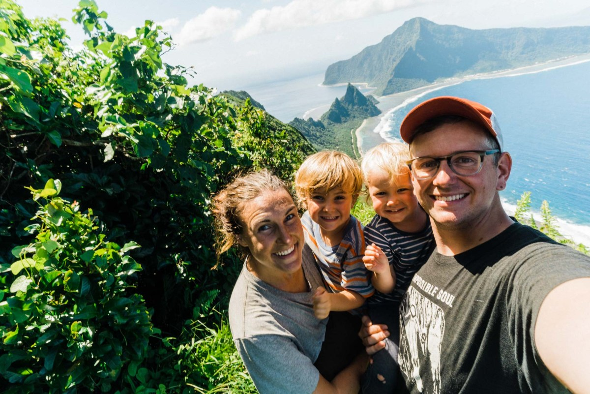 family with kids hiking on the island of ofu in the national park of american samoa