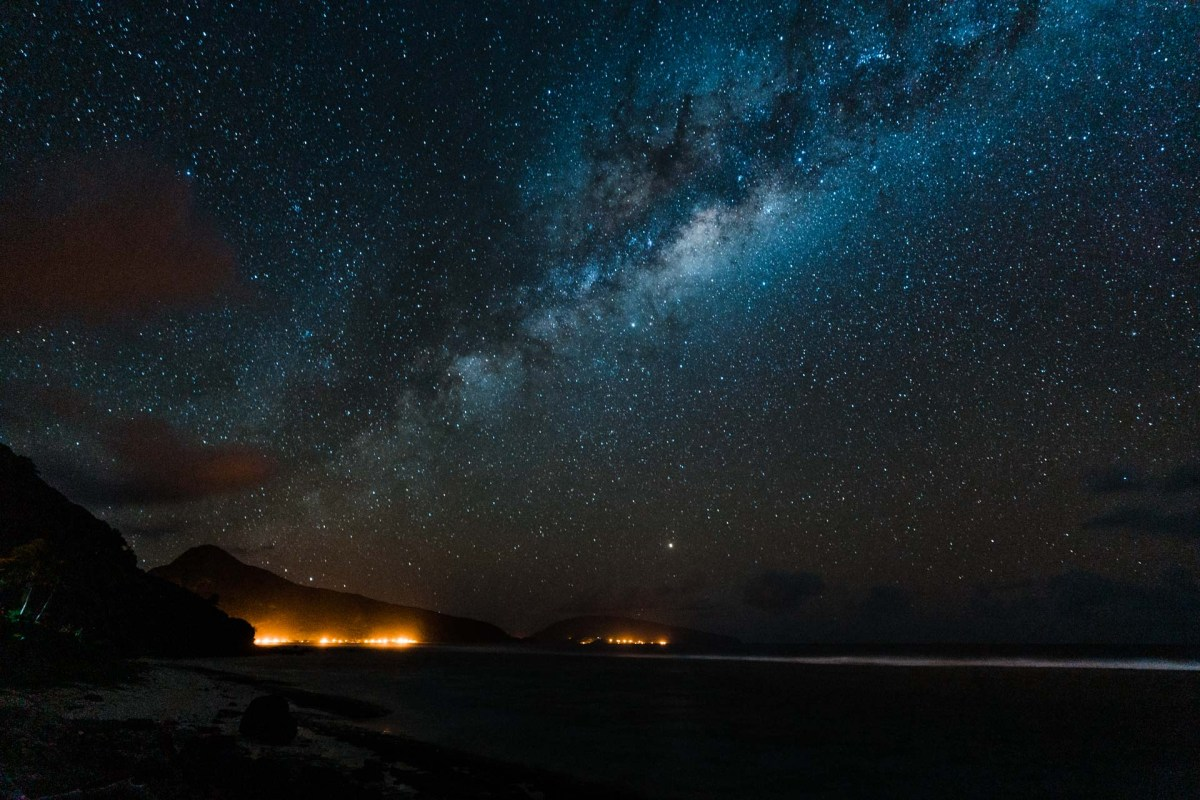 the milky way over the island of ofu in the national park of american samoa