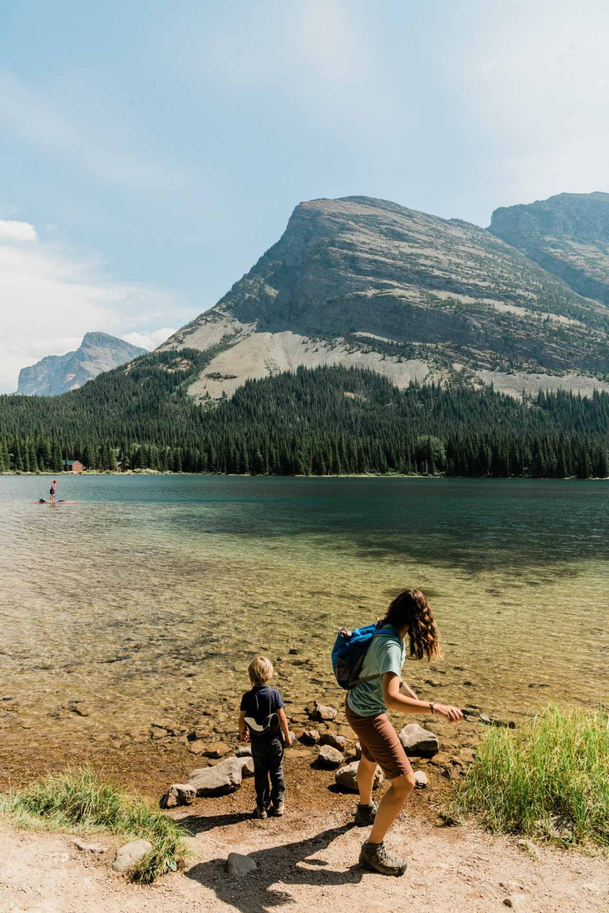 family with kids hiking in glacier national park