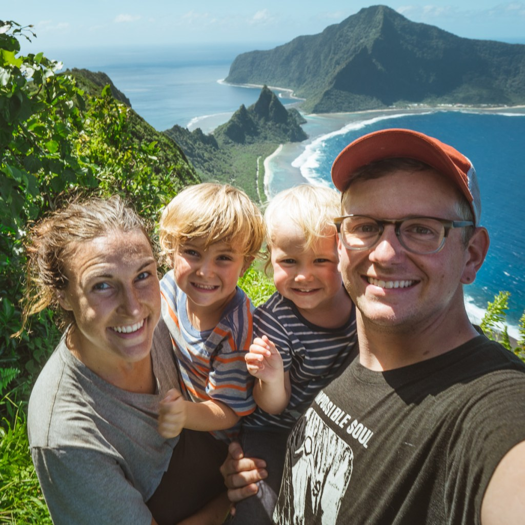 a family with kids hiking in the national park of american samoa