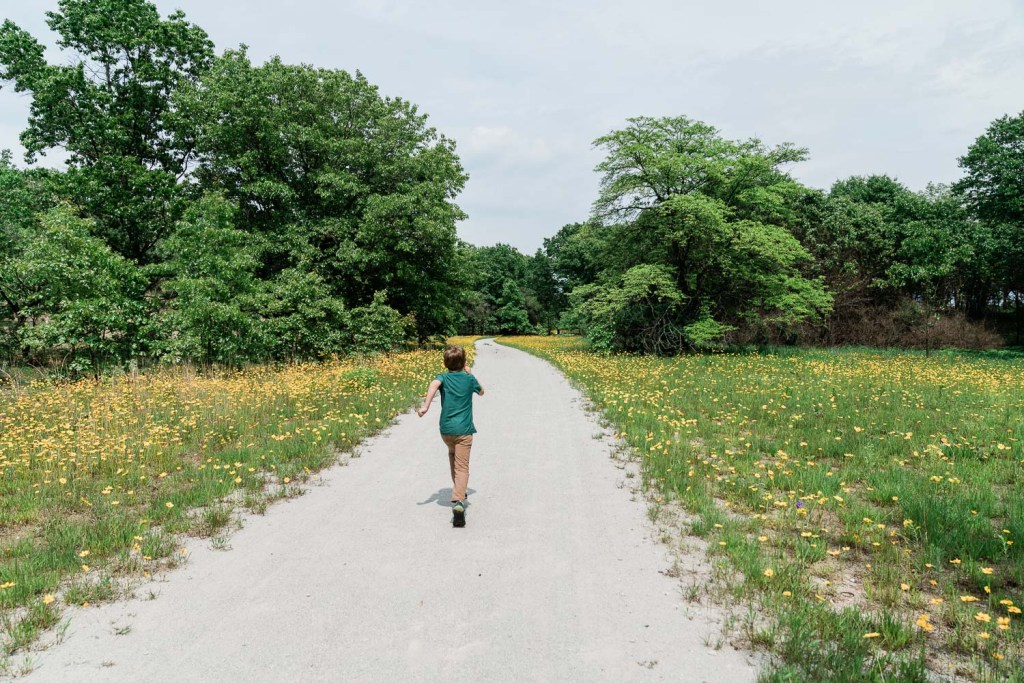 kid running on the marquette trail in indiana dunes national park