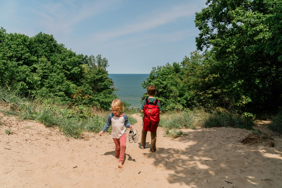 family with kids hiking the 3 dune challenge in indiana dunes national park
