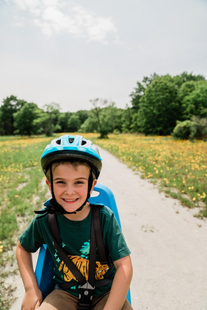kid riding a bike on the marquette trail in indiana dunes national park