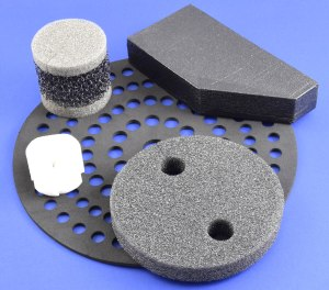 Various types of open cell urethane materials, custom manufactured and die cut by American Flexible Products.