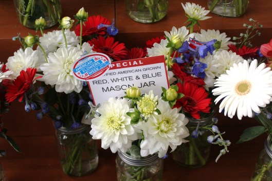 Certified American Grown Red-white-and-blue mason jars on sale for $12.99 at New Seasons. The bouquet featured red and white dahlias and gerberas with blue delhiniums.