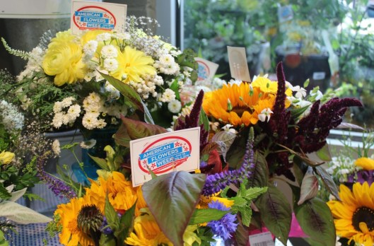 Tags appear on bouquets large and small to alert customers about the origins of each flower.