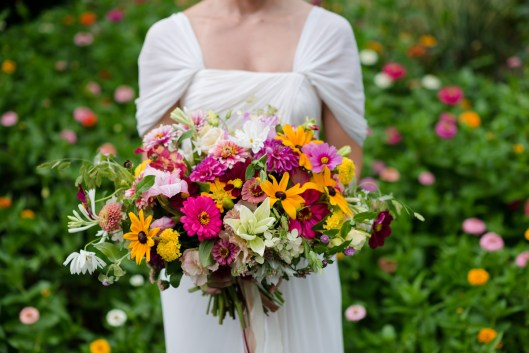 The lovely bouquet explodes with zinnias, rudbeckia, dahlias, lilies, cosmos, tuberoses, ornamental grasses and much more.