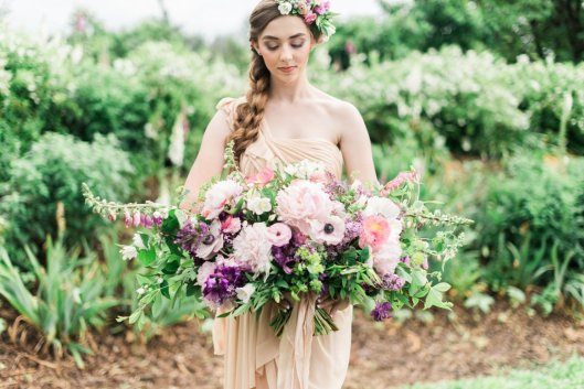 "Kelly's ""spring story"" focuses on a girl who is out in the flower fields picking every element of her wedding flowers -- and then designing them. © Joy Michelle Photography"