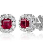 Armadani ruby and diamond halo studs.