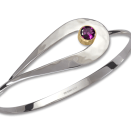 Silver and 14k gold Cleo bracelet by Ed Levin Jewelry featuring a Rhodolite garnet.