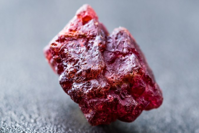 Uncut and rough natural red spinel crystal.
