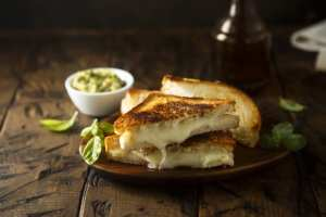 Grilled cheese on a plate with garnishes