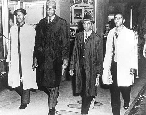 Ezell A. Blair, Jr. (now Jibreel Khazan), Franklin E. McCain, Joseph A. McNeil, and David L. Richmond leave the Woolworth store after the first sit-in on February 1, 1960. (Courtesy of Greensboro News and Record)