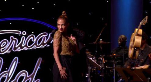 Jennifer throws Quentin's coat over her shoulder