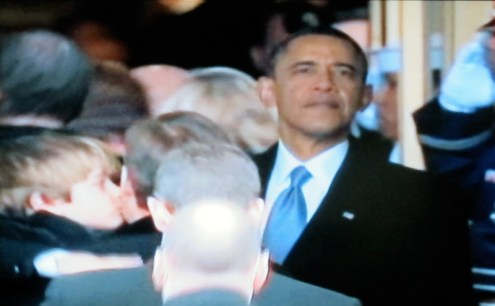 The president looks back on the Inaugural crowd (Photograph of PBS coverage)