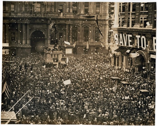 Massive crowds gathered around a replica of the Statue of Liberty near Philadelphia's city hall to celebrate news of the Armistice, November 11, 1918.