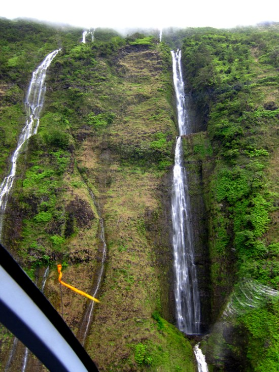 looking up at the waterfalls falling in the sea valleys.