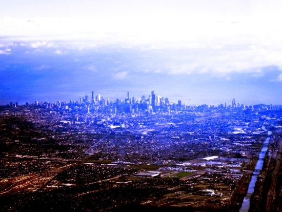 heavily tweeked aerial shot of downtown and industrial Chicago