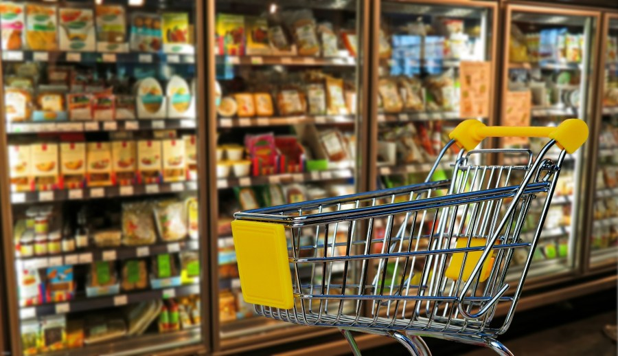 Shopping cart inside of grocery store.